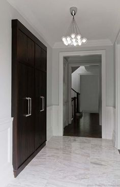 Suzie: Michael Abrams Limited - Modern foyer with cool gray paint color, chocolate brown ...