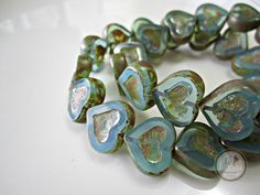 SAVE 10% use coupon code PIN10 Beautiful opal blue heart Czech glass picasso beads, just a gorgeous heart bead! Quantity: 4 Size: 14x12mm ITEM#: 4H-V3-14 Please stop by my other Etsy shops: ... #supplies #bead