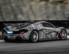 """The McLaren debuts at the Geneva Auto Show . In the meantime McLaren has cut out the middle man and released in-house released its own in-house """"spy shots"""" and video of the racetrack-camoed supercar spitting fire from the exhaust. Mclaren P1, Supercars, Best Camouflage, Dazzle Camouflage, E90 Bmw, Automobile, Mc Laren, Geneva Motor Show, Car Videos"""