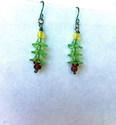Little green Christmas tree dangle earrings by BeadingByJenn, $6.50