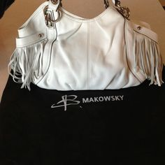 FLASH SALEWhite B. Makowsky Fringed Purse •REDUCED• White with fringes on the side pockets. Dust Bag included. Buttery soft leather-Non structured so it doesn't stand on its own. Bought last yr in time for summer & it's sat in the dust bag. Never used. B Makowsky Bags