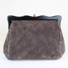 Grey quilted Chanel clutch.
