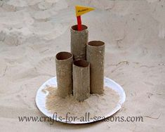 Summer craft...Sand castle made with paper towel and toilet paper rolls.  This craft is for the smaller kids, unless you want to alter it to make it a little more complex.
