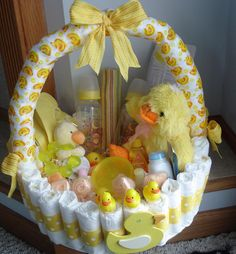 Diaper Basket: Not too keen on the diaper cake idea? Grab a diaper basket like this diaper basket centerpiece ($75) by Teresa Phillips to keep the tradition without lifting a finger.