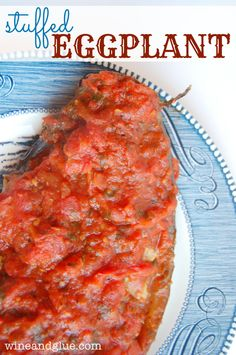 Stuffed Eggplant | www.wineandglue.com | Delicious eggplant stuffed with spicy sausage and topped with homemade red sauce!