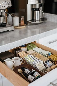 The tea Drawer Inside the tea drawer, I store individual tea packets in a wire utensil tray. A shallow wood bowl found in France is used to keep the stevia bottles from rolling around, and a few small ironstone creamers are easy to grab when setting a bre Coffee Station Kitchen, Coffee Bar Home, Home Coffee Stations, Coffe Bar, Coffee Bar Station, Coffee Bar Design, Coffee Tray, Coffee Room, Küchen Design