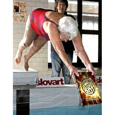 Zdena Snoblova demonstrates her diving technique while holding the 2011 Guinness Word Records book. The 90-year-old woman from Pelhrimov in the Czech Republic, has been recognized by Guinness World Records as being the oldest diver in the world