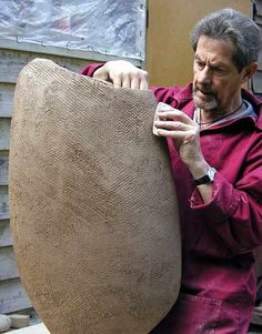 Ceramics by Alan Foxley at Studiopottery.co.uk - 2014. Alan Foxley at work on a 7_ sculpture.