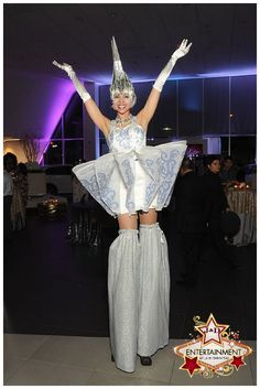 whimsical white and silver Stilt character provided by J&D Entertainment in Houston, TX for the Love Wins Launch party.  photographer: Eric Kleiman from www.weddingphotographyonbudget.com