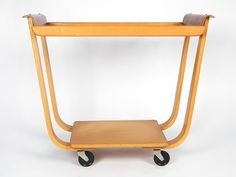 Very nice serving trolley -Rolo PB31- designed in the early 50s by Cees Braakman for Pastoe. This trolley is made of two types of curved plywood. Original Midcentury Modern Dutch Design. We ship world wide. See our website for more detailed information