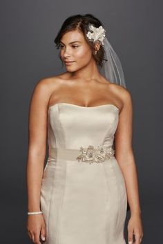 Simple yet elegant, this chic trumpet gown paired with sash style S1057 offers a bold and timeless look!   David's Bridal Collection.  Also available Regular, Petite, Extra Length and Plus Size Extra Length. Check your local stores for availability.  Fully lined. Imported. Dry clean only.  Cherish your wedding dress forever with our Wedding Gown Preservation Kit.