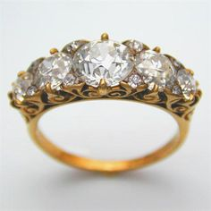 A VICTORIAN CARVED HALF HOOP FIVE STONE DIAMOND RING