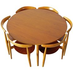 Hans Wegner Table and Six Heart Chairs | From a unique collection of antique and modern dining room sets at http://www.1stdibs.com/furniture/tables/dining-room-sets/