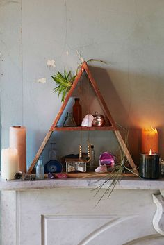 Magical Thinking Pyramid Shelf Really simple but really cute! Could easily pull blank walls together.
