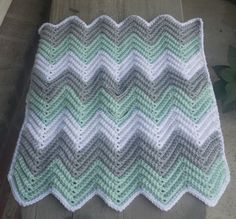 Crochet chevron baby blanket with holes for car seat straps