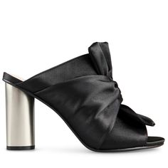Crafted from stunning silky black satin, these breathtaking mules are effortless…