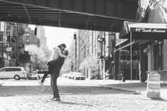 Gavin lifts Laudine into the air near High Line Park during their engagement session with NYC wedding photographer Ben Lau.