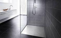 Kylpyhuoneen suihkutilan seinä ja lasinen suihkuseinä unidrain.fi