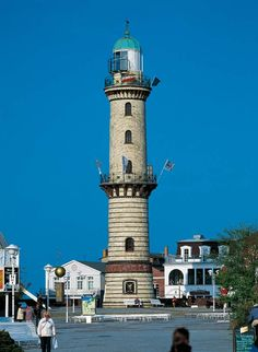Warnemunde Lighthouse is situated on the estuary of the Warnow River in Warnemunde, Germany.  The lighthouse has a height of 121 feet and was put into service in 1898 and was automated in 1978.  Photo: google.com