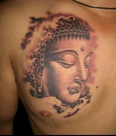 Fading Buddha tattoo - The color of this chest tattoo really makes it look great.