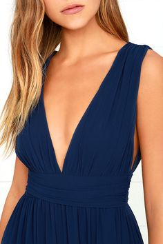 You'll be goddess-like for the entire evening in the Heavenly Hues Navy Blue Maxi Dress! Georgette fabric drapes alongside a V-neck and back, and lays across a banded waist. Full maxi skirt has a sexy side slit. Hidden back zipper with clasp.
