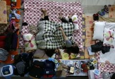 Family members of a missing passenger on board the capsized South Korean ferry Sewol rest as they wait for news from rescue and salvage teams in a makeshift accommodation at a gymnasium in the port city of Jindo April 21, 2014. REUTERS/Kim Kyung-Hoon