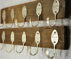 Using bent spoons and engraving your family names on them is a great idea. Just attach to a nice plank of vintage looking wood.
