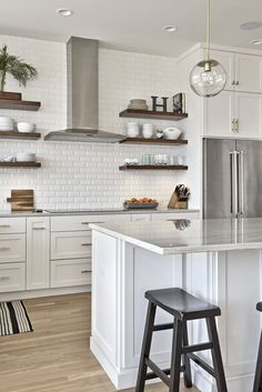 This modern farmhouse was styled by LRSI for interior design photoshoot bringing small details through home accessories to this modern kitchen of white cabinetry, steel appliances, floating shelves and classic white subway tile backsplash Farmhouse Style Kitchen, Modern Farmhouse Kitchens, Home Kitchens, Small White Kitchens, Subway Tile Kitchen, White Tile Backsplash Kitchen, White Subway Tiles, Floating Shelves Kitchen, Floating Cabinets