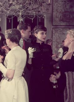 Audrey Hepburn at a party in her honour after the filming of Roman Holiday, London, 1953.