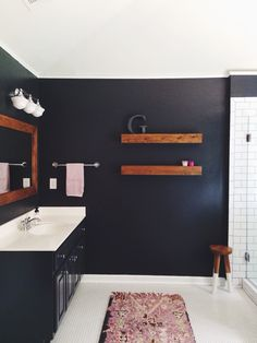 navy and wood Bathroom with Dark Walls + White Subway Tile. Wrought Iron by Benjamin Moore. White Bathroom Tiles, Bathroom Renos, Bathroom Wall Decor, Bathroom Interior Design, Navy Bathroom, White Tiles, Bathroom Lighting, Bathroom Ideas, Wood Bathroom