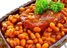 This recipe for Boston baked beans uses navy beans, molasses, brown sugar, and ketchup to create a wonderful old-fashioned baked bean flavor. No bacon needed! Easy Baked Beans, Baked Bean Recipes, Top Recipes, Side Dish Recipes, Cooking Recipes, Beans Recipes, Potluck Recipes, Breakfast Recipes, Dessert Recipes