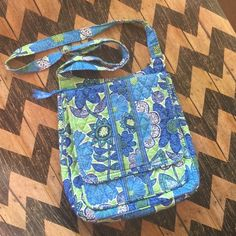 """Vera Bradley Crossbody Messenger Bag EUC!  Not sure of the pattern but Super cute in blues, greens, and white. Quilted Vera Bradley Crossbody messenger bag.  Magnetic front pocket flap with 2 compartments. Top zip for main bag opening with 2 cell phone compartments. 1 small zip compartment on back of bag.  12"""" tall x 13"""" wide. Adjustable strap from 14"""" drop to 27"""". Vera Bradley Bags Crossbody Bags"""