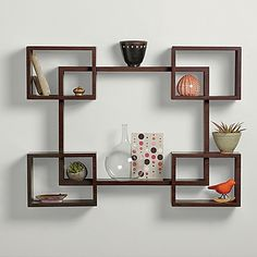 Dress up your walls and add some functional display options with this Interlocking Decorative Rectangle Shelf Set from Real Simple. Decorated with a smooth espresso-colored finish, the cubes in the shelf set are versatile and allow for many arrangements.