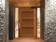 Entrance: Example of Pivot timber Entry Door - Corinthian Pivot Windsor Less expensive option is to paint existing front door same grey as feature wall. Timber Front Door, Front Door Design Wood, Wooden Front Doors, Modern Front Door, House Front Door, The Doors, Entrance Doors, Garage Doors, Front Entry