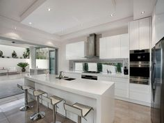 Straight line kitchen with island, low level slimline window, rangehood over window | realestate.com.au/home-ideas