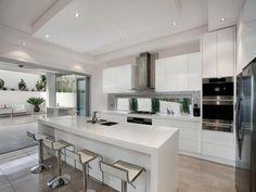 Straight line kitchen with island, low level slimline window, rangehood over window   realestate.com.au/home-ideas