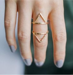 Triangle gold rings