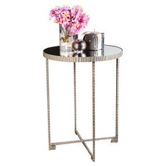 A stylish canvas for fresh bouquets or a stack of fashion magazines, this chic end table showcases a silver-finished iron base and mirrored top.