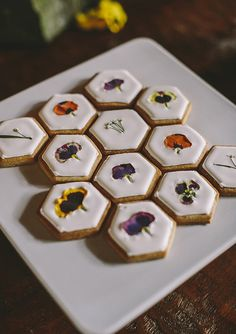 Edible flower cookies. Chic wedding dessert idea | via 100 Layer Cake