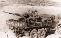 ЗиЛ-131 с установленной в кузове 23-мм спаренной зениткой ЗУ-23-2. Афганистан