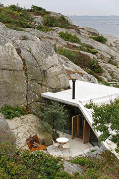 Designed by Lund Hagem, the thoughtfully-sited holiday retreat harmonizes with its surrounding landscape.