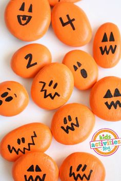 How to make painted pumpkin rocks and a link to the homemade math game that kids can play with them.