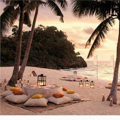 beach wedding tables and cushions