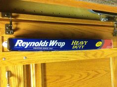 Use Command™ Hooks to hang Reynolds wrap...awesome space & clutter reliever!