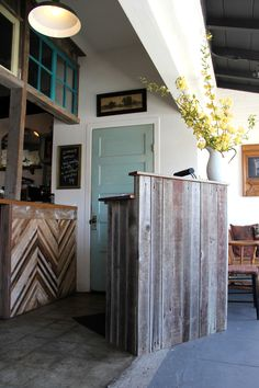 The view when you first walk in, this host station is built from an old redwood fence and the windows were donated by a customer during our...