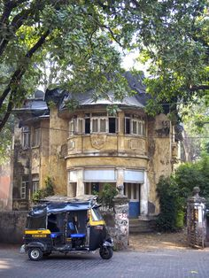 A colonial era bungalow in Bandra, a suburb of Bombay (Mumbai) i love the way the trees are close in Bandra
