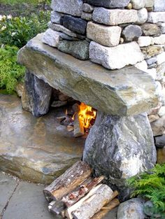 Stone fireplace ~ absolutely beautiful! I'm thinking I could stack some rocks.