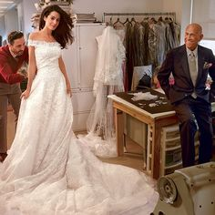 Alma Clooney and the late Oscar de la Renta.The gown is swirls around her like an ocean of beauty.