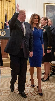 President Donald Trump and first lady Melania Trump depart a Medal of Freedom ceremony in the East Room of the White House in WashingtonTrump Medal of Freedom, Washington, USA - 16 Nov 2018 Donald Trump Family, Donald And Melania Trump, First Lady Melania Trump, Malania Trump, John Trump, Milania Trump Style, Melania Knauss Trump, Blue Cocktail Dress, Hollywood Celebrities