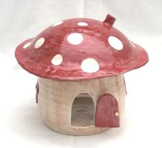 This hand thrown white earthenware mushroom house has a door and two windows, and an access opening at the back. It's glazed in cream and is hand decorated with brown, red and yellow ceramic enamels. Pottery Houses, Ceramic Houses, Pottery Painting Designs, Paint Designs, House Lamp, Mushroom House, T Lights, Glitter Houses, Earthenware